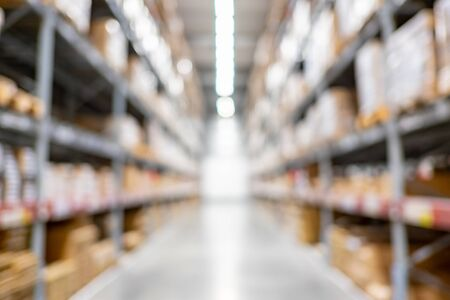 blur background of storage warehouse with boxes packaging on shelf