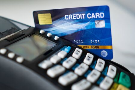 close up swiping credit card for buying or selling product, business and payment concept Standard-Bild