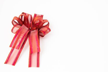 close up red ribbon or bow decorate on present box concept Standard-Bild