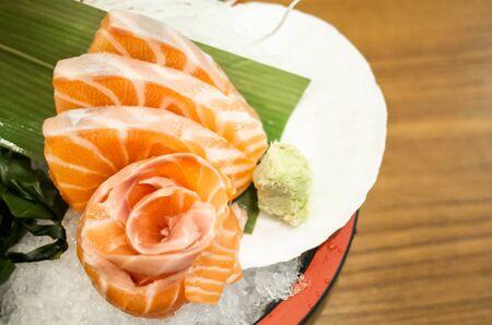 Sliced salmon sashimi served on platter, Japanese food delicious menu Standard-Bild