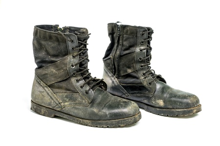 Dirty boots isolated on white background. Stock Photo - 17167896