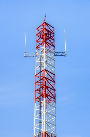 small antenna of Communication Building and blue sky in Thailand. photo