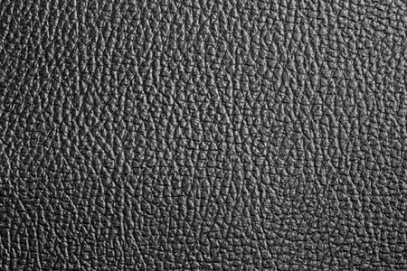 Texture of artificial leather surface. Black background or leatherette backdrop for design. Stock Photo - 98965572