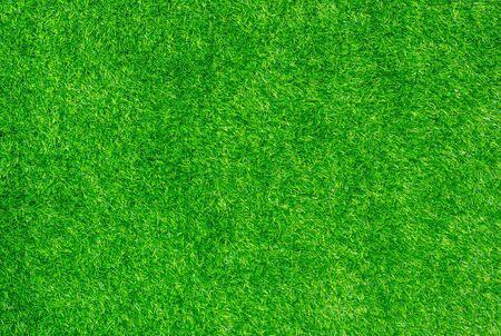 Uso de césped artificial de decoración verde para fondo deportivo. Foto de archivo
