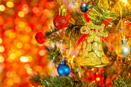 Christmas tree decorations against light background and New Year holidays background.