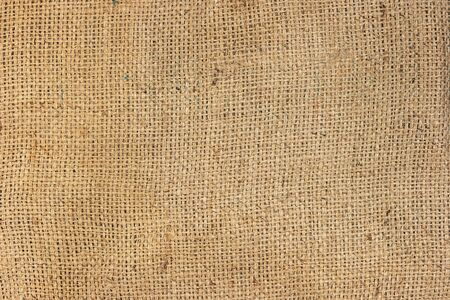 Brown sackcloth texture surface background with copy space for wallpaper backdrop. Close up background of natural brown fabric sack weaving is a bag for packing