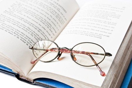 eyeglass on book photo