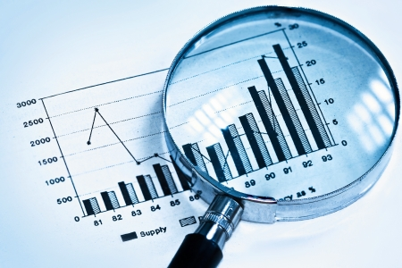research study: magnifying glass on graph Stock Photo