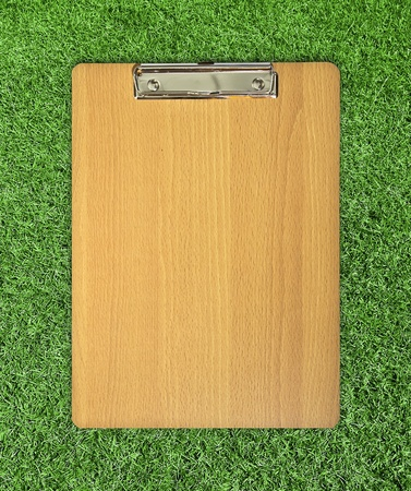 ruled: clip board on grass