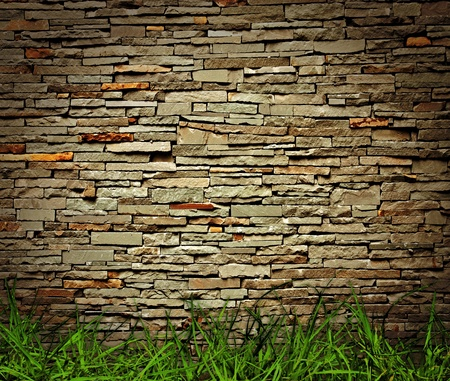grass and brick wall background photo