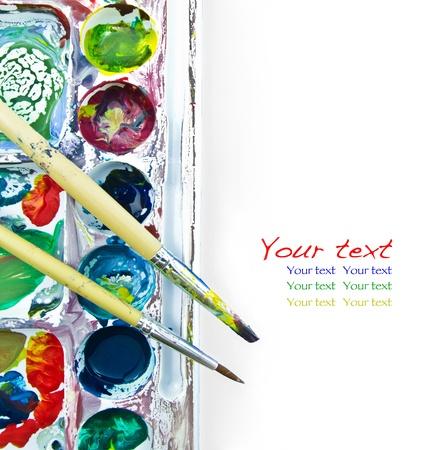 art palette: paintbrush and palette on white