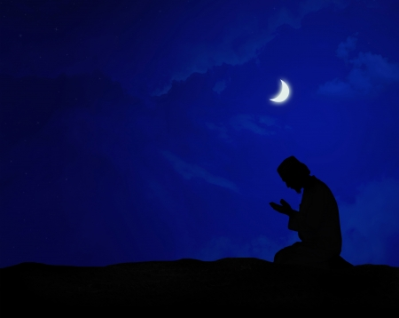 muslim praying at night under the moon Stock Photo - 9893677