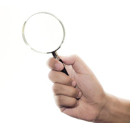 Vergrootglas in de hand op een witte achtergrond Stockfoto - 10014797