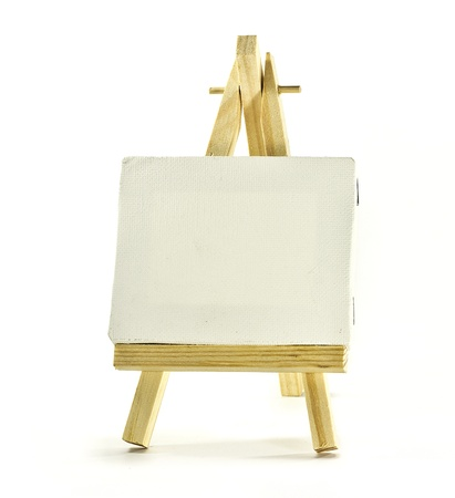 blank canvas on wooden easel over white Stock Photo - 10032342