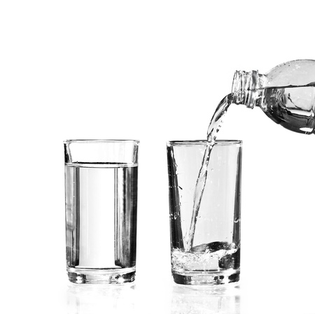 glass half full: a full glass of water and an empty glass to be filled