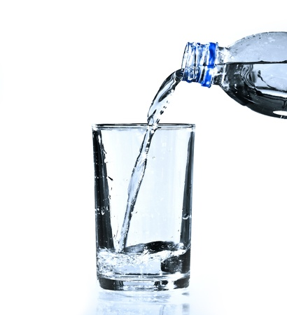 Glass and bottle with pure water over white Stock Photo - 10207568