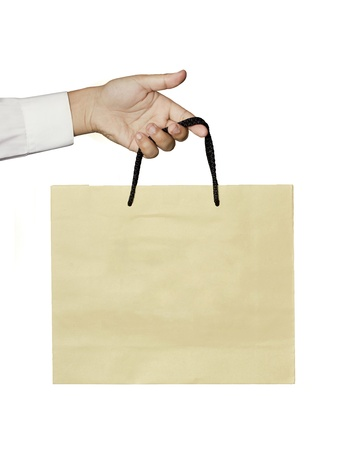 paper bag: brown bag with hand isolated on white