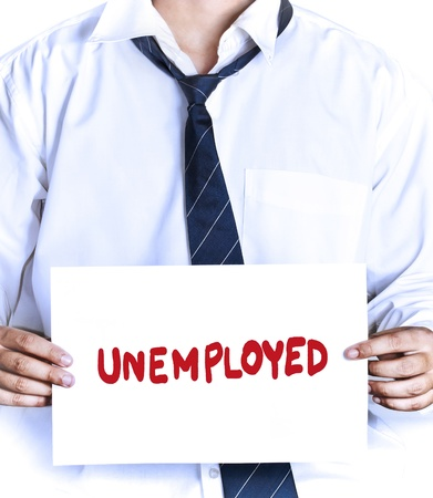 fired employee holding unemployed sign to seek a job photo