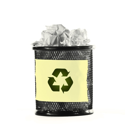 wastepaper basket: paper in recycle bin over white