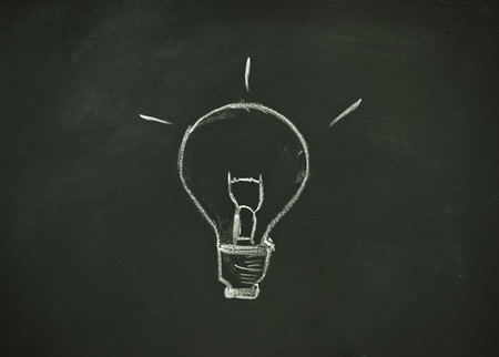 drawing bulb by chalk on blackboard background