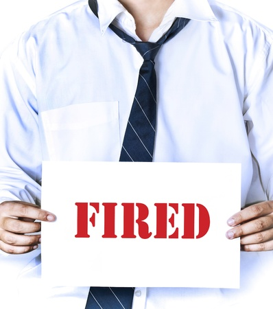 fired employee holding fired sign in hand