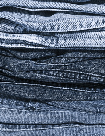 a pile of blue jeans background