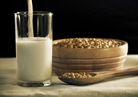 soymilk: soy milk with beans in spoon Stock Photo