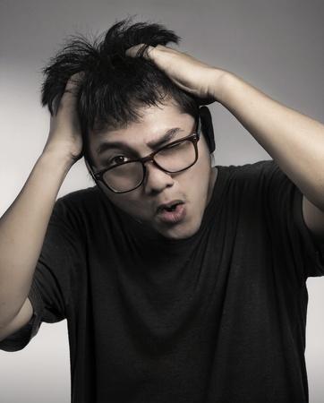 cashual man holding hand on his head (headache)