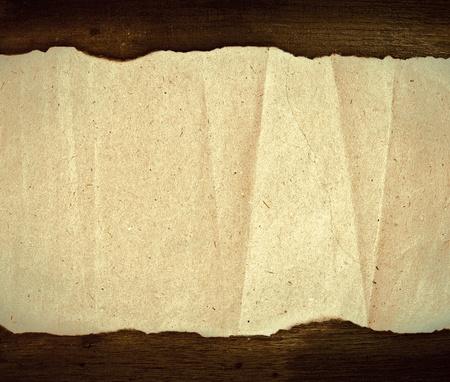 quemado: textura de papel viejo y la madera de fondo Foto de archivo