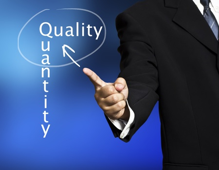 quantity: a business man pointing quality and quantity
