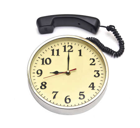 calling time clock face and telephone over white  photo