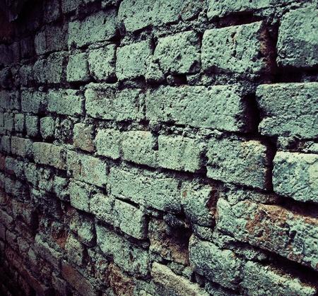 donkere oude bakstenen muur met grunge textuur Stockfoto