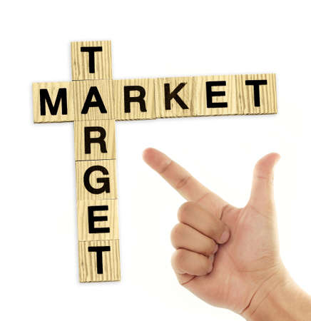 hand with market and target crossword over white Stock Photo - 12773549
