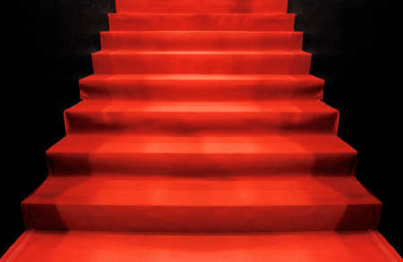 red carpet up stairs in the dark photo