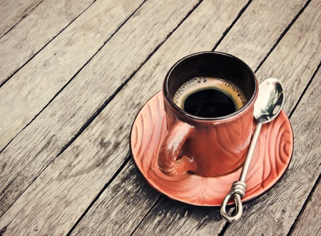 stimulant: a hot espresso cup on wooden table Stock Photo