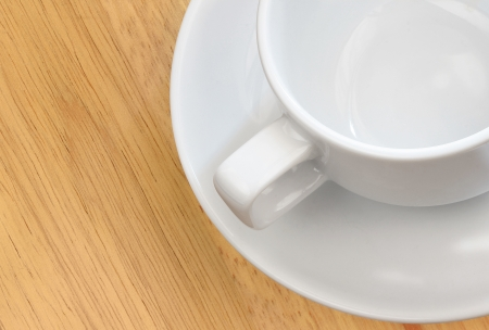 white empty cup on wood background Stock Photo - 14414054