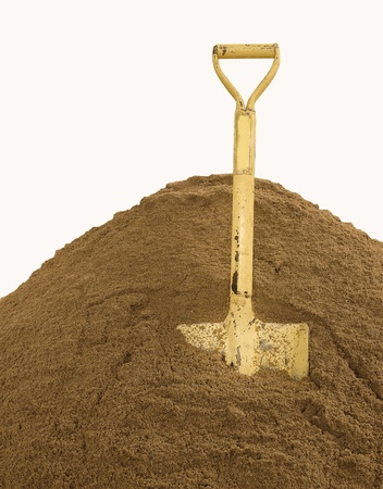shovel in dirt: a construction shovel on sand over white