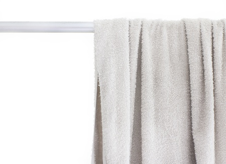 towel on a hanger isolated over white Stock Photo - 15473455