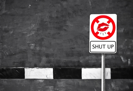 sidewalk talk: stop mouth sign and footpath background