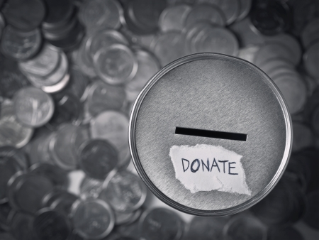 donation box with coins in monotone photo