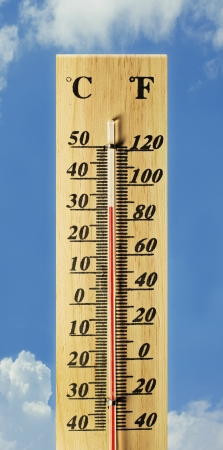 celsius: wooden thermometer on blue sky Stock Photo