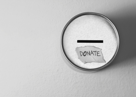 cash box: donate box over gray background