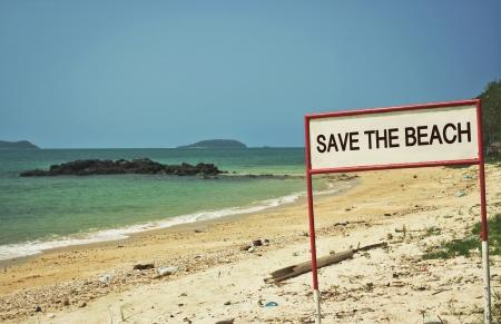 greenpeace: save the beach sign on the beach