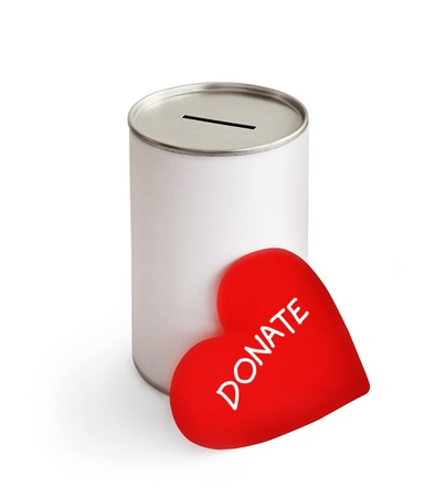 red heart and donation can on white photo
