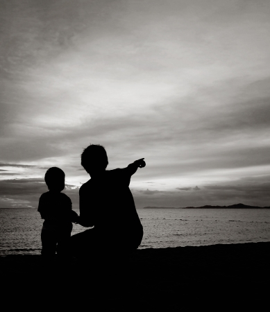 father and son on the beach photo