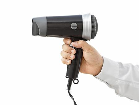 secador de pelo: hombre de negocios la celebración de secador de pelo Foto de archivo