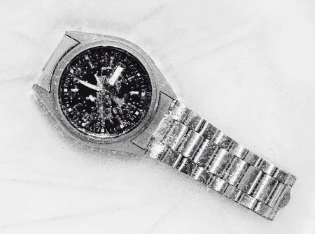 stop time: stop time concept through a frozen watch