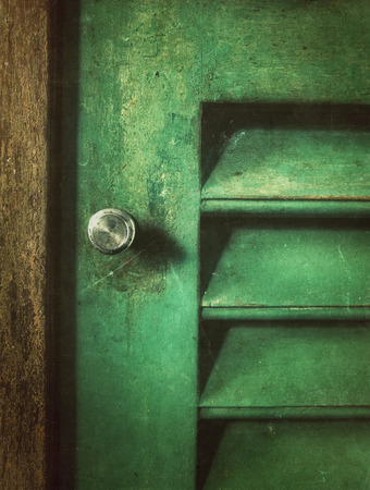 antique furniture: grungy old wood cabinet door Stock Photo