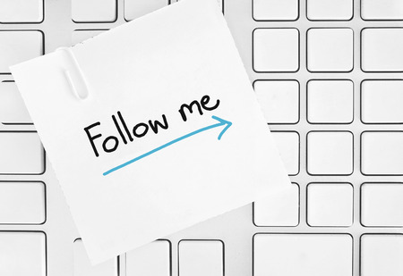 follow me paper on keypad Stock Photo - 26824869
