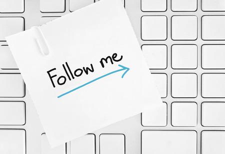 follow me paper on keypad Stock Photo - 26824869